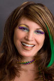 Pretty Laughing Woman in Mardi Gras Makeup. A portrait of a gorgeous young woman in brightly colored makeup Royalty Free Stock Photos
