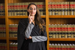 Pretty lawyer looking at camera in the law library Royalty Free Stock Image