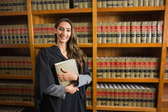 Pretty lawyer looking at camera in the law library Stock Image