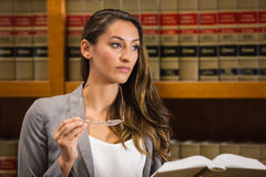 Pretty lawyer reading in the law library Royalty Free Stock Images