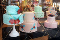 Pretty layered cakes in shop window Royalty Free Stock Photo