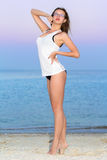 Pretty leggy woman. Wearing glasses and white t-short posing on the beach Royalty Free Stock Photos