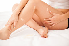 Pretty legs filled with bandages Royalty Free Stock Photos