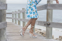 Pretty legs in high heels relaxed at beach Royalty Free Stock Images