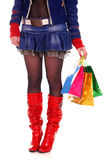 Pretty legs with holiday bags. Pretty female legs with a holiday bags Stock Photos
