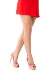 Pretty legs in mini skirt and high heels Stock Photography
