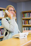 Pretty librarian answering the phone Stock Photo