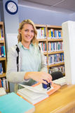 Pretty librarian working in the library Stock Images