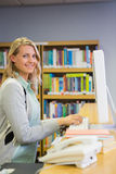 Pretty librarian working in the library. At the university Stock Images