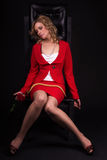 Pretty lifeless lady in red with snake Royalty Free Stock Photos