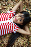 Pretty little asian girl laying Stock Photo