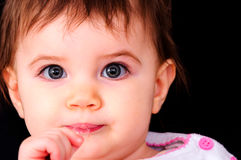 Pretty little baby on black Royalty Free Stock Photos