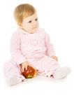 Pretty little baby eat the Apple Royalty Free Stock Photos