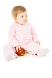 Pretty little baby eat the Apple Stock Photos