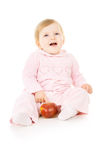 Pretty little baby eat the Apple Stock Photography