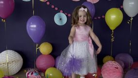 Pretty little baby girl laughing and playing on her birthday party stock video