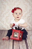 Pretty little baby girl playing with coffee grinder Royalty Free Stock Photography