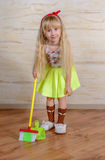 Pretty little blond girl cleaning the house Royalty Free Stock Photo