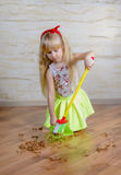 Pretty little blond girl cleaning the house Royalty Free Stock Images