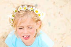 Pretty Little Blond Girl with a Crown of Daisies Stock Images