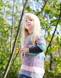 Pretty Little Blond Girl at the Forest Stock Photos
