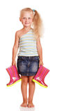 Pretty little blond girl stands and holding rubber boots isolated. Royalty Free Stock Images