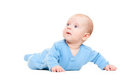Pretty little boy in blue romper suit Stock Image