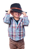 Pretty little boy plays with cowboy hat Stock Image