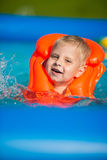 Pretty little boy in swimming pool Stock Photos