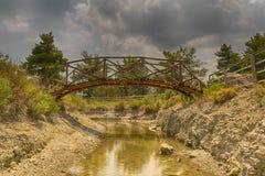 Pretty little bridge in Beletsi lake in Greece. Royalty Free Stock Photography