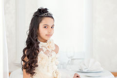 Pretty little brunette posing in tiara, close-up Stock Photos