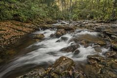 Cascade. A pretty little cascade in western North Carolina. Seen here with autumn colors in October stock photography