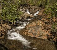 Cascade. A pretty little cascade in western North Carolina. Seen here with autumn colors in October stock photo