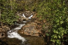 Cascade. A pretty little cascade in western North Carolina. Seen here with autumn colors in October royalty free stock photography
