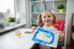 Pretty little child girl painting with colorful paint  at home. Pretty little child girl painting winter with colorful paint at home Royalty Free Stock Photo