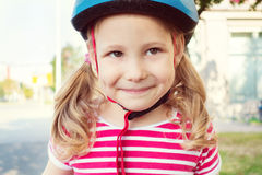 Pretty little child girl ride and having fun with bicycle in par Stock Image