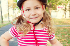 Pretty little child girl ride and having fun with bicycle in par Stock Photos