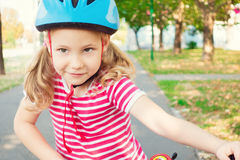 Pretty little child girl ride and having fun with bicycle in par Royalty Free Stock Photography