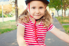 Pretty little child girl ride and having fun with bicycle in par Stock Photography