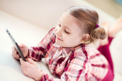 Pretty little child girl using a digital tablet Stock Image