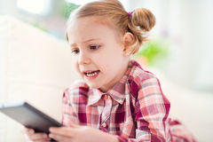 Pretty little child girl using a digital tablet Royalty Free Stock Photo