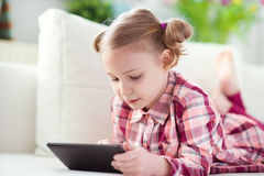 Pretty little child girl using a digital tablet Stock Photo