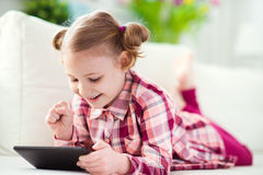 Pretty little child girl using a digital tablet Royalty Free Stock Photography