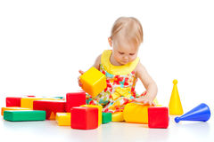 Pretty little child playing with color toy Royalty Free Stock Photos