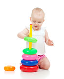 Pretty little child playing with color toy Stock Photos