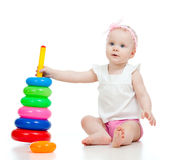 Pretty little child playing with color toy Royalty Free Stock Images