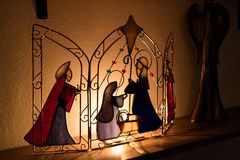 Pretty little Christmas Nativity scene. On a wire work frame lit from behind by a glowing light Royalty Free Stock Photography