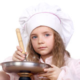 Pretty little cook Stock Photography