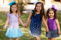 Pretty little friends holding hands Stock Photo