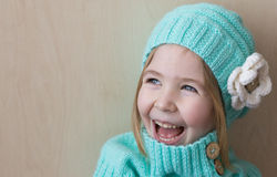 Pretty little funny girl. Blue eyes. Stock Photo